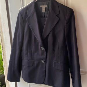 Navy blue and teller suit